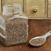 jar and tablespoon of chia seeds