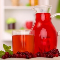 Pitcher and glass of cranberry juice with red cranberries