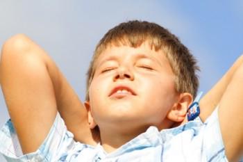 Young child sunbathing