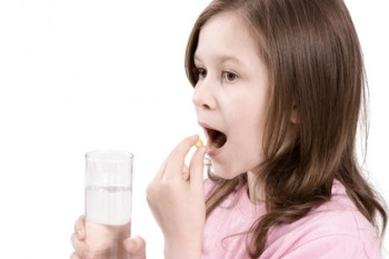 Child taking a multivitamin